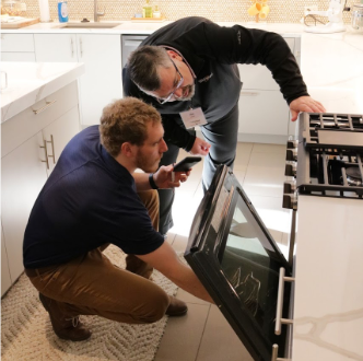 World of Whirlpool staff inspecting equipment before an event
